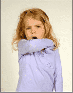 Girl coughing into elbow